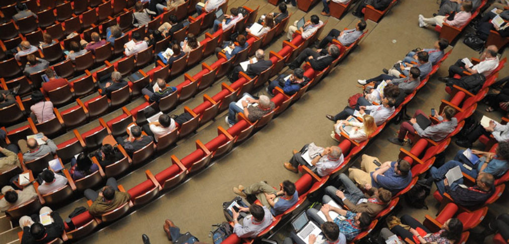 people in an auditorium for a Real Estate Investor meetup